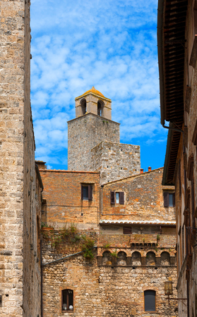 Towers and old buildings in San Gimignano medieval town, Siena, Tuscany, Italy photo