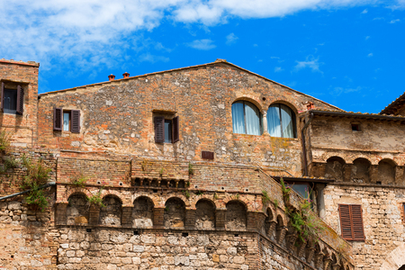Old fortifications and buildings in San Gimignano medieval town , Siena, Tuscany, Italy photo