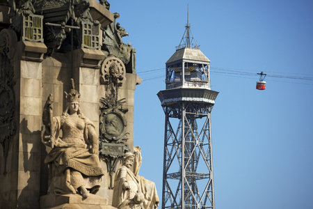 Cable car from Montjuic in Barcelona, Spain with iron tower, in the foreground  blurred  the Monument to Christopher Columbus