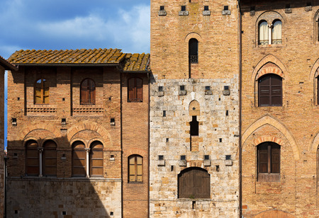 Tower Chigi and Buildings in Piazza del Duomo, San Gimignano medieval town   , Siena, Tuscany, Italy photo