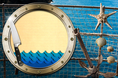 Metal porthole with blue waves and yellow paper, kitchen knife, seashells, starfish and rusty anchor. Template for recipes or seafood menu photo