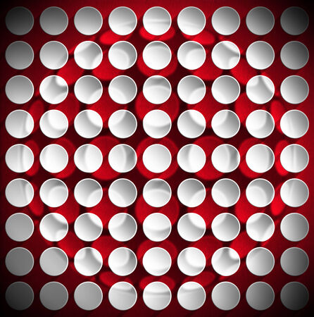 Abstract background with many white and gray circles with shadows on a red velvet background photo