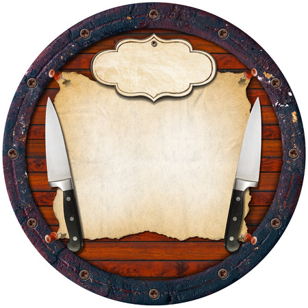 Wooden background (Bottom of a barrel) with two kitchen knives, empty parchment and label. Background for a rustic menu photo