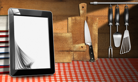 Tablet computer with blank pages and stack of books in a kitchen, on wooden wall with kitchen utensils. Template for recipes or food menu photo