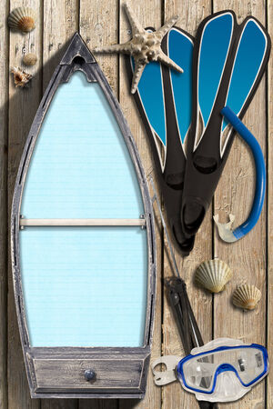 speargun: Small wooden row boat with empty blue paper inside on wooden wall with equipment for spearfishing, seashells and starfish Stock Photo
