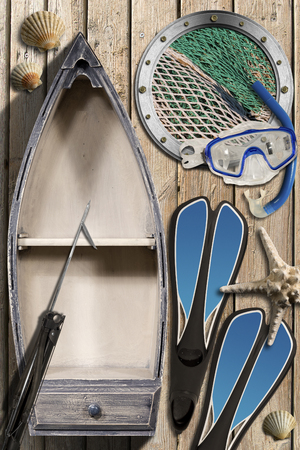 Small wooden row boat on wooden wall with equipment for spearfishing, metal porthole with fishing net, seashells and starfish photo