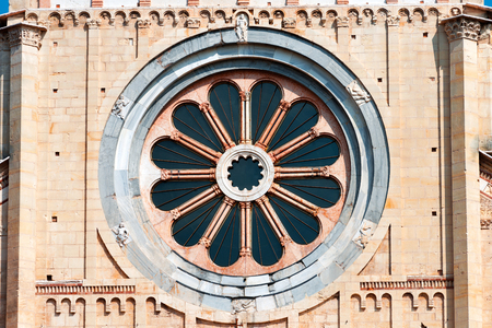 Detail of ancient circular rose window of the Basilica of San Zeno (X-XI century) in Verona Italy. Also known as the Wheel of Fortune photo