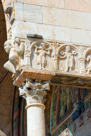 Detail of ancient porch of the Basilica of San Zeno (X-XI century) in Verona Italy. Is considered one of the masterpieces of Romanesque architecture in Italy Stock Photo