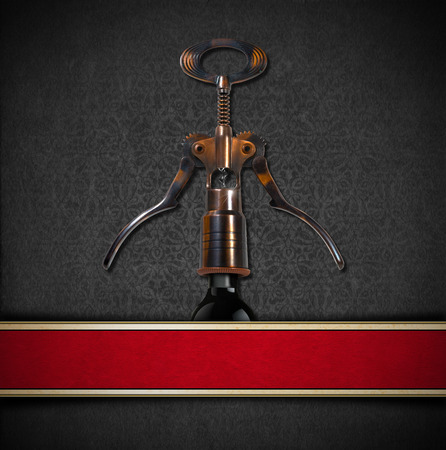 Gray and red velvet background with ornate floral seamless, old corkscrew and black bottle. Template for wine list or menu photo