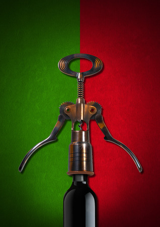 Red and green velvet background with an old corkscrew and black bottle. Template for wine list or menu photo