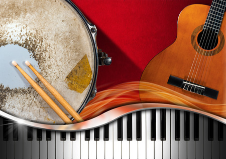 Red velvet background with acoustic guitar, piano keyboard and metallic old snare drum. Concept of music performance