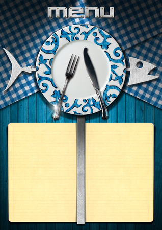 Restaurant fish menu with metal fish, yellow empty pages, empty plate with silver cutlery on wood blue background with blue and white checkered tablecloth photo