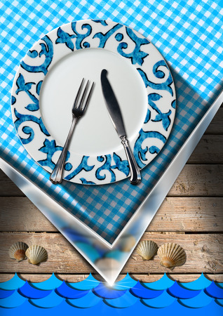 Wooden background with sand, blue waves, seashells, blue and white checkered tablecloth and empty plate with cutlery. Table set for a seafood menu photo
