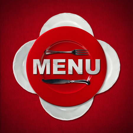 Restaurant menu with a red plate and four white plates with silver cutlery on red velvet background with shadows. Text Menu in white ceramic photo