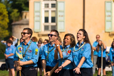 VERONA, ITALY - OCTOBER 5, 2014: Four chiefs scout smiling during the opening of the Scout activities AGESCI, Association of Italian Catholic Guides and Scouts