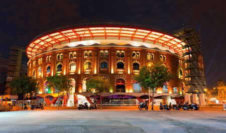 arenas: BARCELONA, SPAIN - JUNE 12, 2014:  Shopping center Las Arenas in Barcelona by night. It was an old bullring opened in 1900 and remodeled as a shopping center. Editorial
