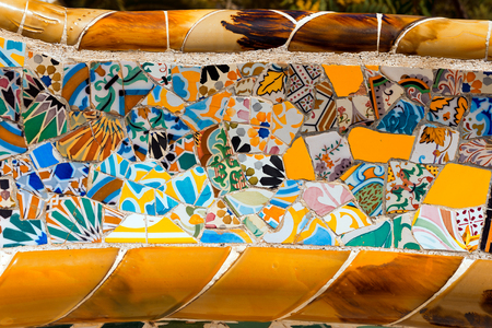 BARCELONA, SPAIN - JUNE 10, 2014: Detail of a ceramic bench in the Park Guell designed by the famous architect Antoni Gaudi (1852-1926). UNESCO, World Heritage Site