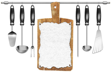 Kitchen utensils and an old wooden cutting board with empty sheet of paper hanging on a steel pole isolated on white background photo