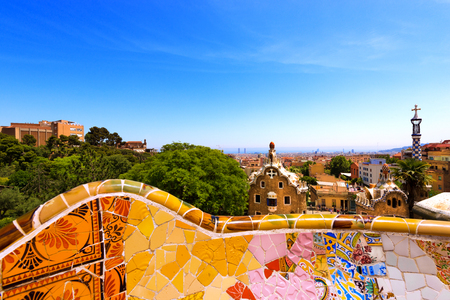 barcelona spain: BARCELONA, SPAIN - JUN 10, 2014: Ceramic bench and buildings in the Park Guell designed by the famous architect Antoni Gaudi (1852-1926). UNESCO, World Heritage Site Editorial
