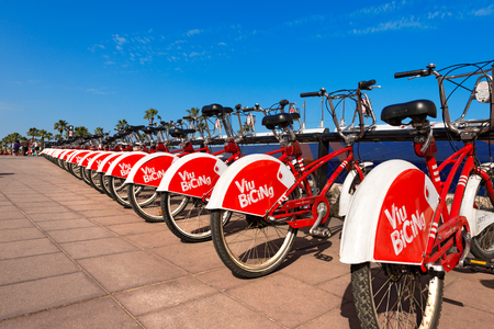 shared sharing: BARCELONA, SPAIN - JUN 10, 2014: Bicycle of the Bicing service in Barcelona sponsored by Vodafone. With the bicing sharing service people can rent bicycles for short trips. Editorial