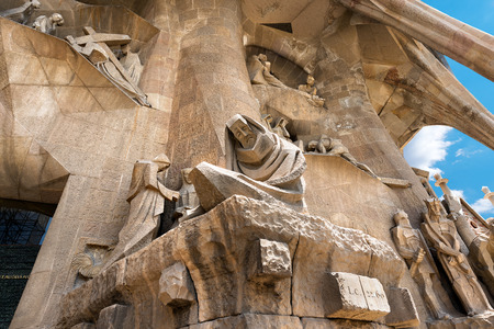 BARCELONA, SPAIN - JUNE 12, 2014: Details of the facade of the famous Catholic basilica of the Sagrada Familia in Barcelona, Catalonia, Spain. Designed by Antoni Gaudi. Start of construction, 1882 Editorial