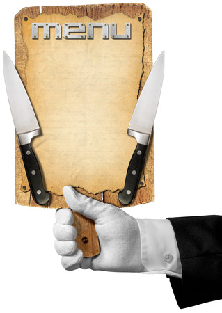 Hand of waiter with white glove holding a old wooden cutting board with empty sheet of paper, two kitchen knives and written menu photo