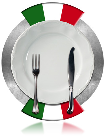 Concept of Italian cuisine with empty white plate and silver cutlery on metal circle with two italian flags isolated on white background photo