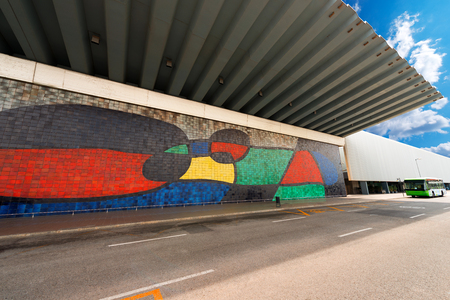 ceramicist: BARCELONA, SPAIN - JUNE 13, 2014: Mosaic of Joan Miro (1970) in collaboration with the ceramicist Josep Llorens Artigas, Large Ceramic Mural in the facade of Barcelona airport
