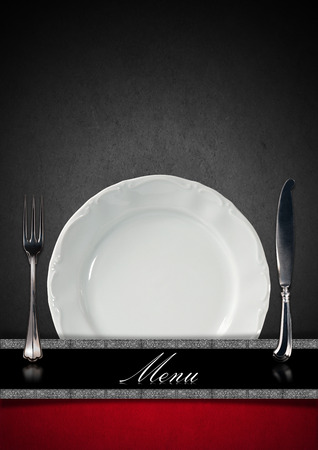 Vertical restaurant menu with empty white plate and silver cutlery, fork and knife on grey, black and red background with horizontal black and silver band photo
