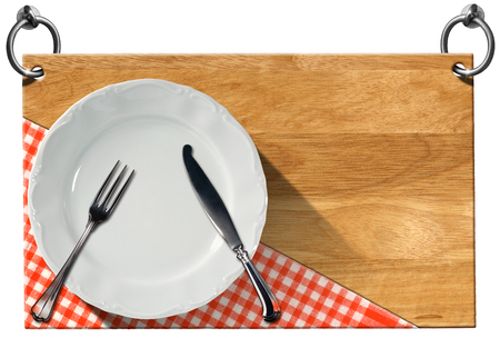 Advertising wooden sign for a restaurant with empty white plate and silver cutlery hanging on to two steel ring with clipping path photo