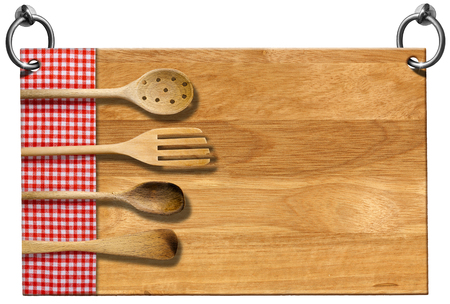 Advertising wooden sign for a restaurant with four wooden kitchen utensils, fork, spoons and ladles on red and white checkered tablecloth. photo