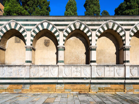 perimeter: Perimeter wall of the cloister of the Basilica of Santa Maria Novella in white marble and green serpentine in Florence, Tuscany Italy