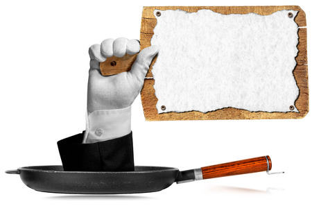 Hand of waiter with white glove come out from a pan with handle and holding an old wooden cutting board with empty sheet of white paper. Isolated on white background photo