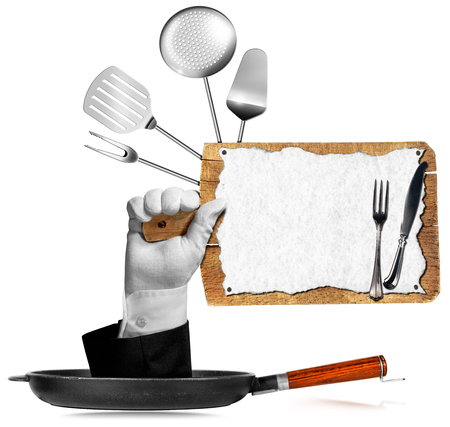 Hand of waiter with glove come out from a pan and holding a wooden cutting board with sheet of paper, kitchen utensils and silver cutlery. Isolated on white background photo