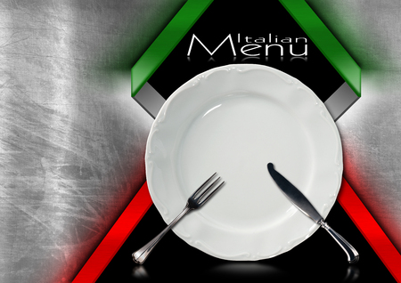 Metallic and black background with italian flag, empty white plate with silver cutlery, fork and knife. Template for a Italian food menu. photo