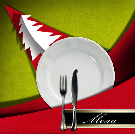 Red and green velvet background with horizontal black band and written menu, empty white plate with silver cutlery and stylized Christmas tree with shadows. Template for a Christmas food menu photo