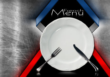 Metallic and black background with French flags, empty white plate with silver cutlery, fork and knife. Template for a French food menu photo