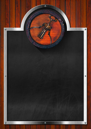 Blackboard with metallic frame and old wooden barrel with corkscrew on dark wooden wall. Template for wine list or menu photo