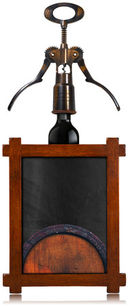 Rustic and empty blackboard with wooden frame, old corkscrew, black wine bottle and old wooden barrel. Template for wine list or menu photo