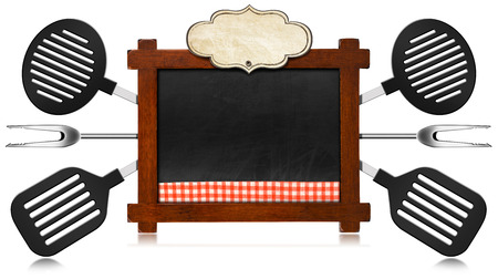 Rustic and empty blackboard with wooden frame and checkered tablecloth, empty label and six kitchen utensils. Template for a recipes or a food menu photo