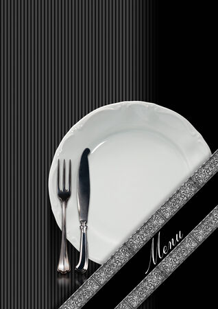 Restaurant menu with empty plate and cutlery, fork and knife, on a black and gray background with diagonal silver bands and written menu photo