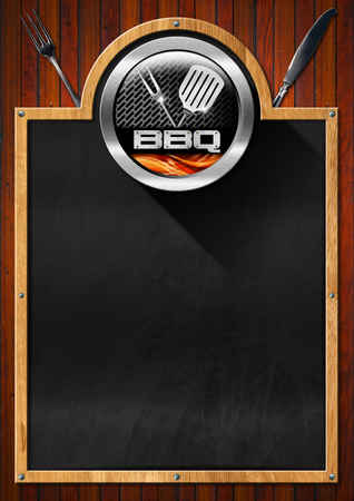 Empty blackboard with wooden frame, symbol of barbecue, fork, knife and spatula, on a wooden wall. Template for recipes or barbecue menu photo