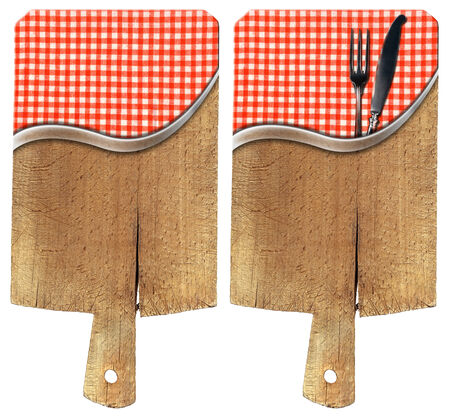 Two wooden cutting boards isolated on white background with red and white checkered tablecloth and cutlery, fork and knife photo