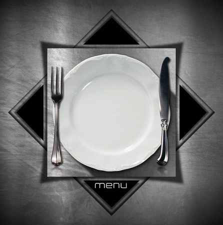Steel stainless background with geometric shapes, square and triangles with empty plate and cutlery. Template for a restaurant food menu photo