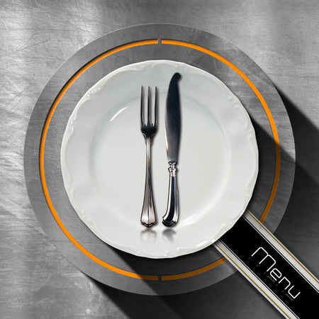 Steel stainless background with circle, empty plate and cutlery, diagonal black band with text, menu. Template for a restaurant food menu photo