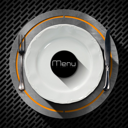White plate with silver cutlery, fork and knife on an orange and metal circle and dark metallic grid. Template for a restaurant food menu photo