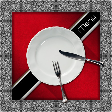 Restaurant menu with silver floral frame on red velvet background, empty plate and cutlery, diagonal black band and written menu photo