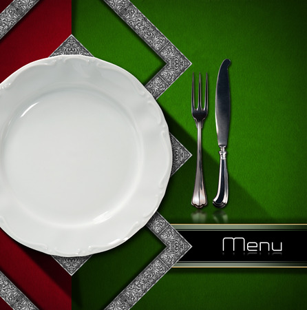 Restaurant menu with red and green velvet background, empty plate and silver cutlery, horizontal black band with written menu photo