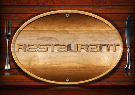 Oval wooden signboard with written menu on wooden wall with silver cutlery, fork and knife photo