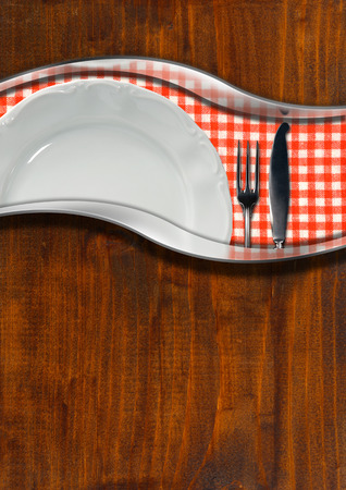 Wooden and metallic background with red and white checkered tablecloth, empty white plate and silver cutlery. Template for a rustic food menu photo